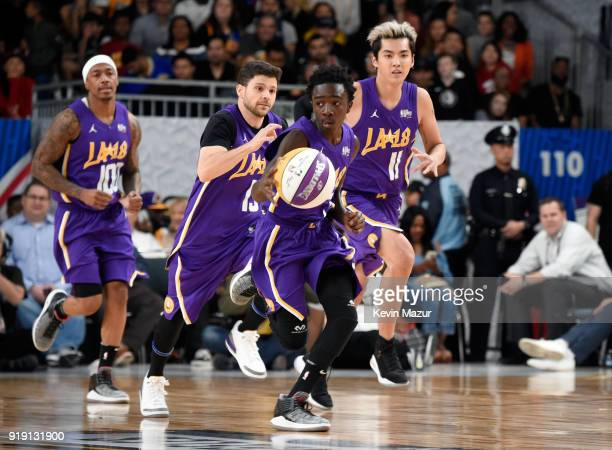 Actor/recording artist Nick Cannon actors Jerry Ferrara Caleb McLaughlin and Kris Wu run down the court during the NBA AllStar Celebrity Game 2018...