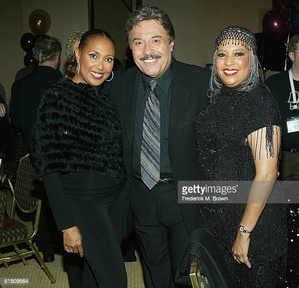 Actor/recording artist Telma Hopkins recording artists Tony Orlando and Joyce Vincent of Tony Orlando and Dawn pose at the Second Annual TV DVD...
