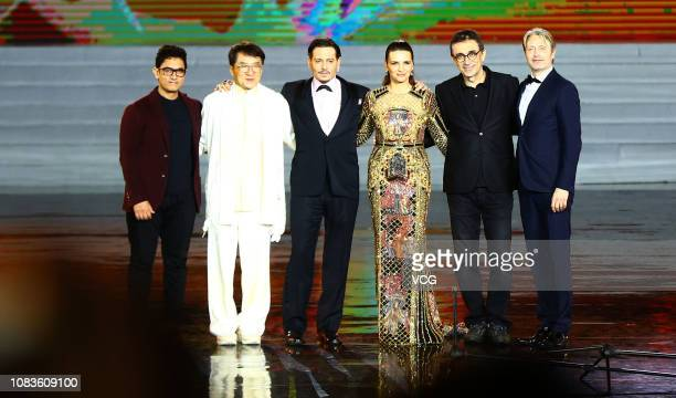 Actors Aamir Khan Jackie Chan Johnny Depp actress Juliette Binoche director Nuri Bilge Ceylan and Mads Mikkelsen attend the closing ceremony of 1st...