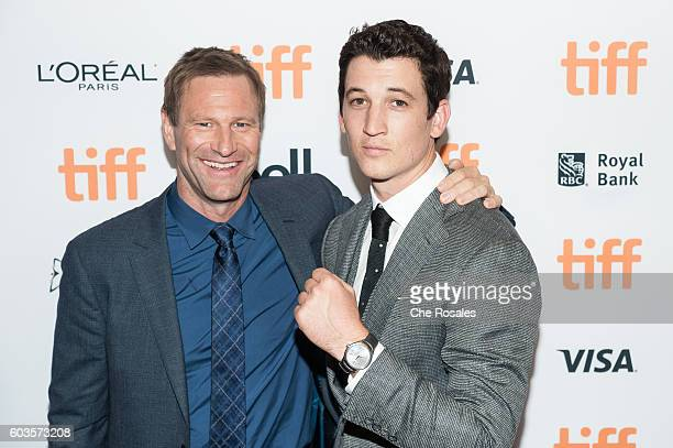 Actors Aaron Eckhart and Miles Teller attend the premier of 'Bleed For This' at Princess of Wales Theatre on September 12 2016 in Toronto Canada