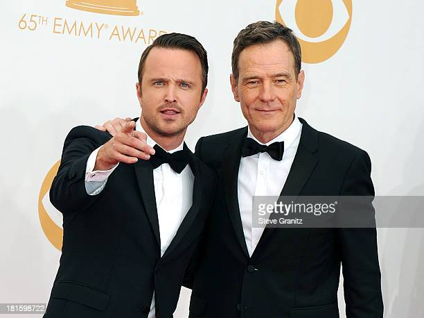 Actors Aaron Paul and Bryan Cranston arrive at the 65th Annual Primetime Emmy Awards held at Nokia Theatre LA Live on September 22 2013 in Los...
