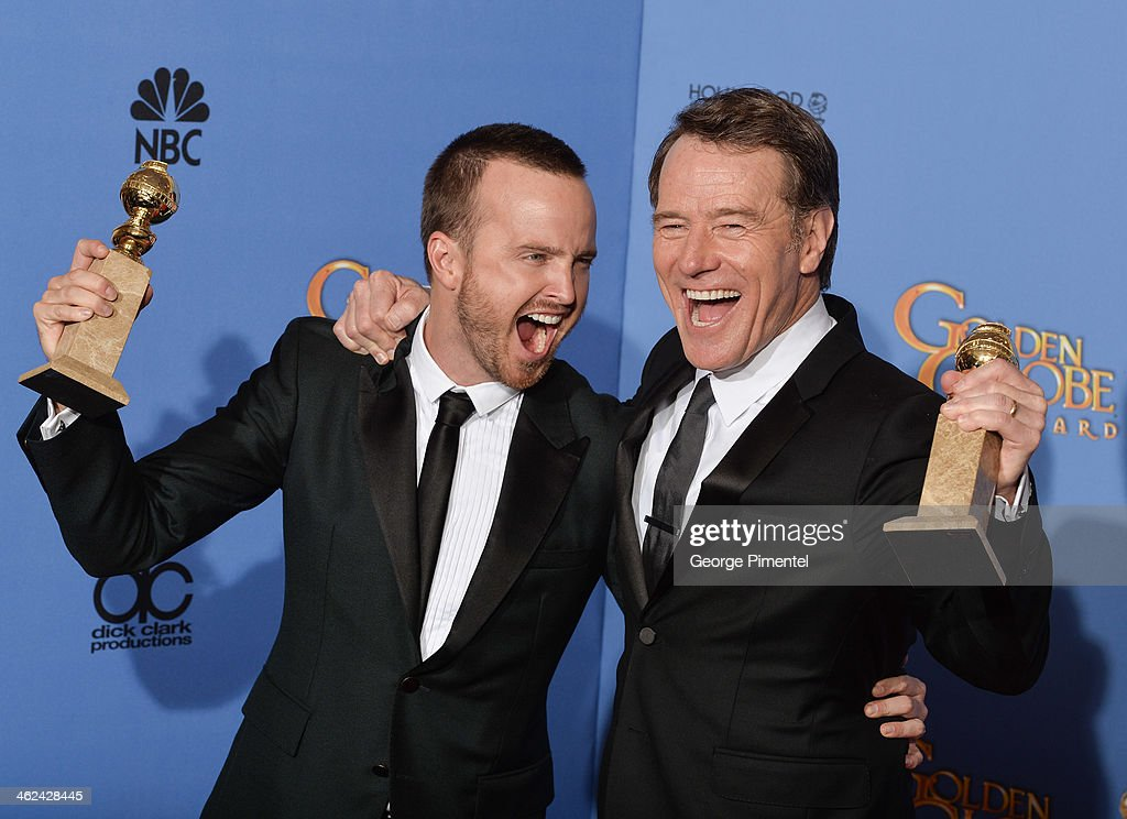 Actors Aaron Paul and Bryan Cranston pose in the press room during the 71st Annual Golden Globe Awards held at The Beverly Hilton Hotel on January 12, 2014 in Beverly Hills, California.