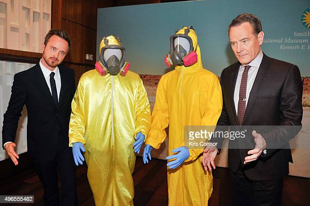Actors Aaron Paul and Bryan Cranston pose with their Tyvek suits during a donation ceremony of artifacts from AMC's Breaking Bad show at...