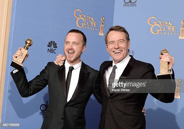Actors Aaron Paul and Bryan Cranston, winners of Best Series - Drama for 'Breaking Bad,' pose in the press room during the 71st Annual Golden Globe...