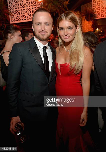 Actors Aaron Paul and Lauren Parsekian attend The Weinstein Company Netflix's 2014 Golden Globes After Party presented by Bombardier FIJI Water Lexus...
