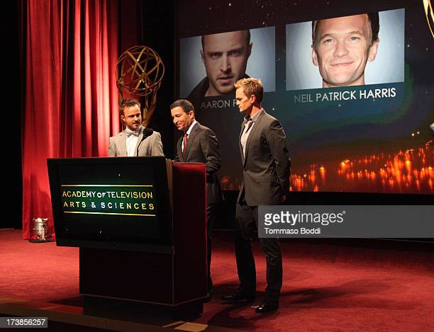 Actors Aaron Paul and Neil Patrick Harris and Academy of Television Arts Sciences Chairman CEO Bruce Rosenblum speak onstage during the 65th...