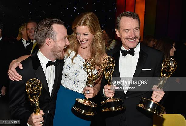 Actors Aaron Paul, Anna Gunn and Bryan Cranston attend the 66th Annual Primetime Emmy Awards Governors Ball held at Los Angeles Convention Center on...