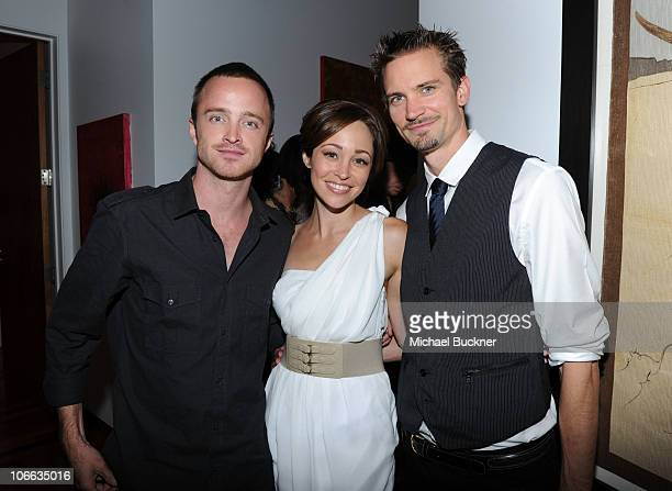 Actors Aaron Paul Katee Sackhoff and Jesse Warren attend the 9th annual InStyle summer soiree hosted by InStyle editor Ariel Foxman and the West...