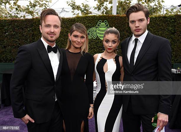 Actors Aaron Paul Lauren Parsekian Sarah Hyland and Dominic Sherwood attend the 23rd Annual Elton John AIDS Foundation Academy Awards Viewing Party...
