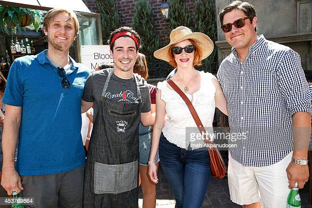 Actors Aaron Staton Ben Feldman Christina Hendricks and Rich Sommer attend Crab Cake 2014 presented by S Pellegrino Samsung Galaxy on August 17 2014...