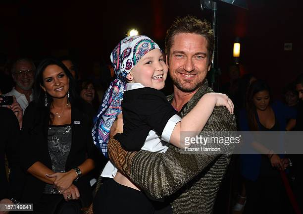 Actors Abella Wyss and Gerard Butler arrive at the special Children's Hospital Los Angeles' Benefit screening of 'Playing For Keeps' at ArcLight...