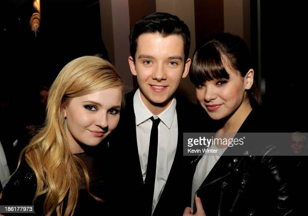 Actors Abigail Breslin Asa Butterfield and Hailee Steinfeld pose at the after party for the premiere of Summit Entertainment's 'Ender's Game' at The...