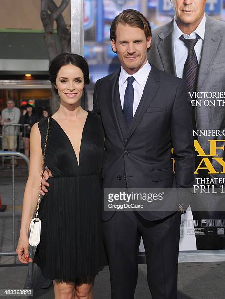 Actors Abigail Spencer and Josh Pence arrive at the Los Angeles premiere of Draft Day at Regency Village Theatre on April 7 2014 in Westwood...
