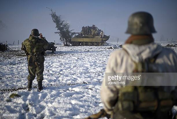 Actors aboard a German Jagpanther tank destroyer take part in the reanactment of the 70th anniversary of the Battle of the Ardennes also known as the...