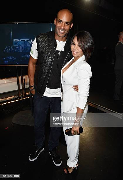Actors Actor Boris Kodjoe and Regina Hill pose backstage at the BET AWARDS '14 at Nokia Theatre LA LIVE on June 29 2014 in Los Angeles California