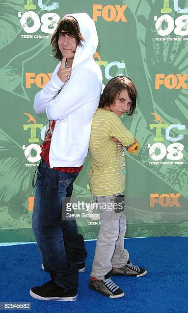 Actors Actors Mitchel Musso and Moises Arias arrive at the 2008 Teen Choice Awards at Gibson Amphitheater on August 3 2008 in Los Angeles California
