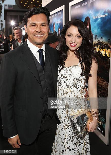Actors Adam Beach and Leah Gibson attend the Los Angeles Premiere of 'Rogue' at ArcLight Cinemas on March 26 2013 in Hollywood California