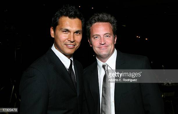 Actors Adam Beach and Matthew Perry pose for photos backstage during the Lili Claire Foundation 10th annual benefit dinner and auction held at the...