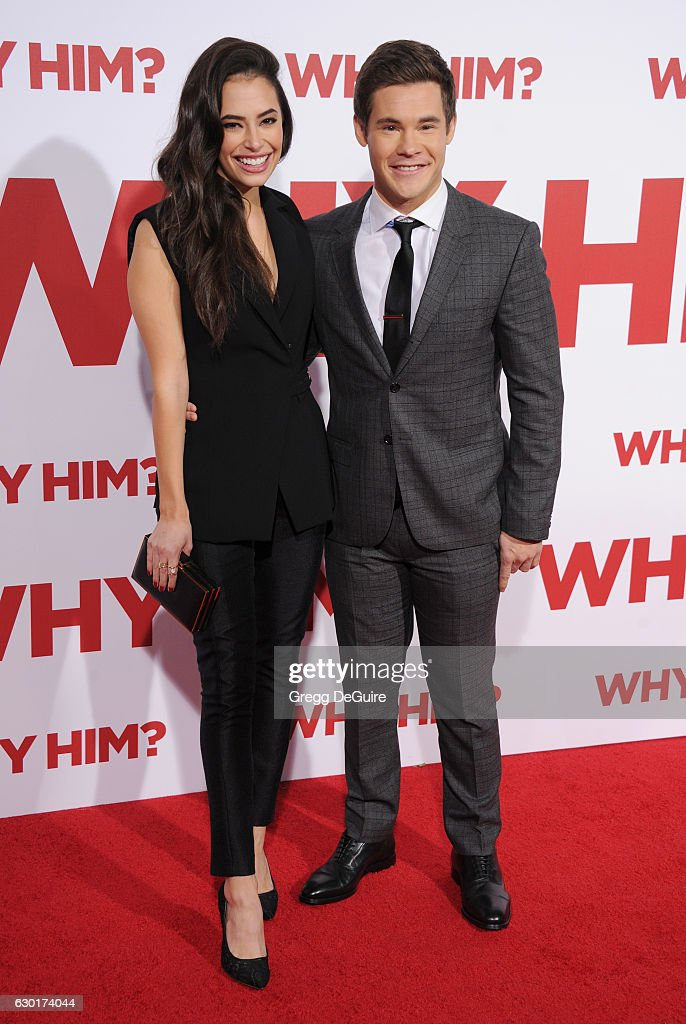 Actors Adam DeVine and Chloe Bridges arrive at the premiere of 20th Century Fox's 'Why Him?' at Regency Bruin Theater on December 17, 2016 in Westwood, California.