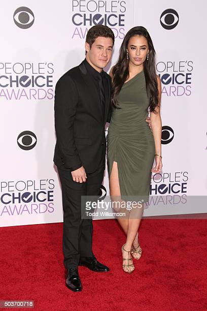 Actors Adam DeVine and Chloe Bridges attend the People's Choice Awards 2016 at Microsoft Theater on January 6 2016 in Los Angeles California