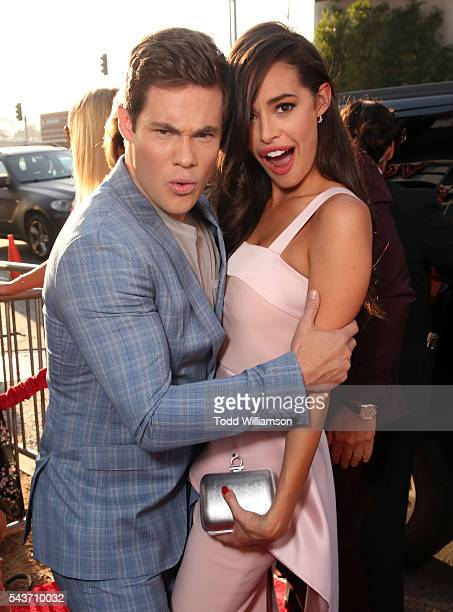 Actors Adam Devine and Chloe Bridges attend the premiere of 20th Century Fox's 'Mike and Dave Need Wedding Dates' at ArcLight Cinemas Cinerama Dome...