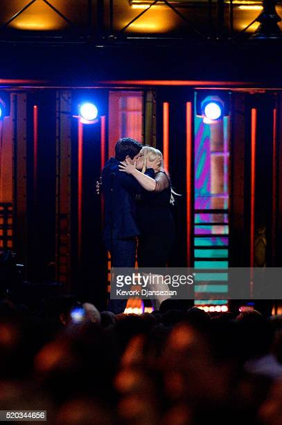 Actors Adam DeVine and Rebel Wilson kiss as they accept the Best Kiss award for 'Pitch Perfect 2' onstage during the 2016 MTV Movie Awards at Warner...