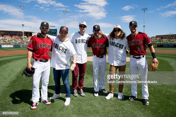 Actors Adam Devine Anders Holm and Blake Anderson pose with Chris Owings Reymond Fuentes and Jack Reinheimer of the Arizona Diamondbacks after...