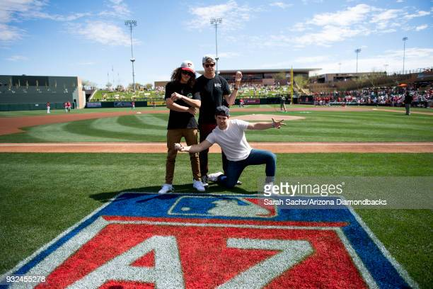 Actors Adam Devine Blake Anderson and Anders Holm pose for a photo before throwing out the ceremonial first pitch prior to an MLB game against the...