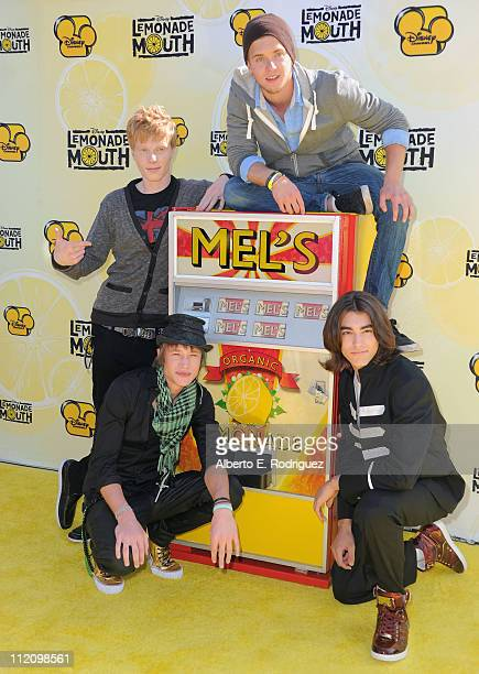 Actors Adam Hicks Chris Brochu Nick Roux and Blake Michael arrive to the premiere of Disney Channel's 'Lemonade Mouth' at Stevenson Middle School on...