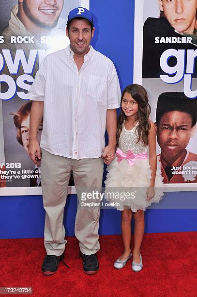 Actors Adam Sandler and Alexys Nycole Sanchez attend the 'Grown Ups 2' New York Premiere at AMC Lincoln Square Theater on July 10 2013 in New York...