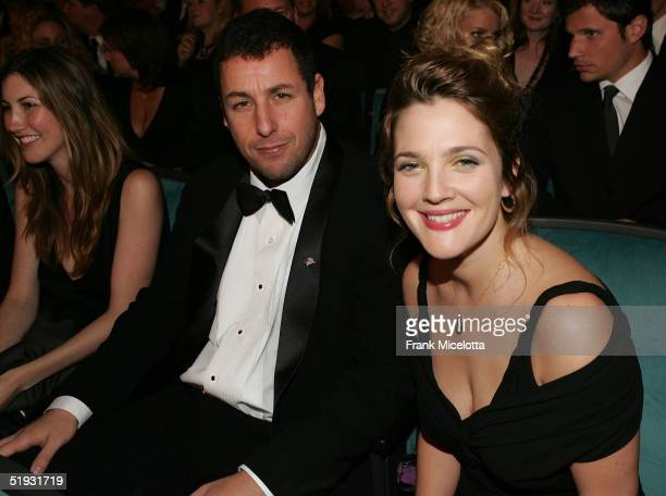 Actors Adam Sandler and Drew Barrymore pose in the audience during the 31st Annual People's Choice Awards at the Pasadena Civic Auditorium January 9...