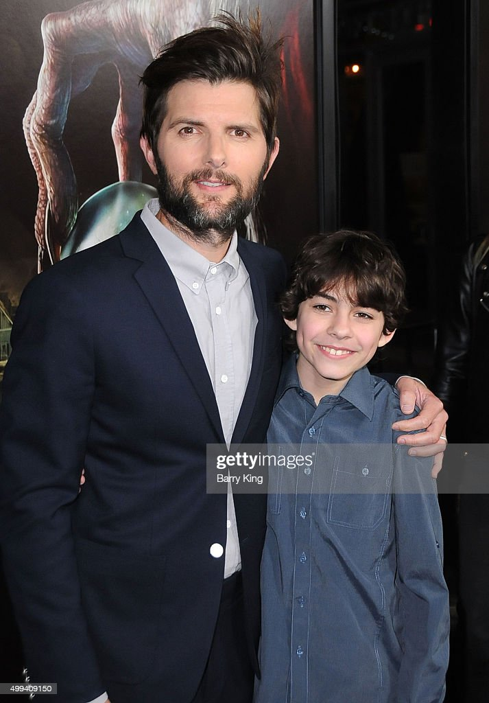 Actors Adam Scott and Emjay Anthony attend industry screening of Universal Pictures' 'Krampus' at ArcLight Cinemas on November 30, 2015 in Hollywood, California.