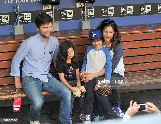 Actors Adam Scott and wife Naomi Scott pose with their children in the Dodger dugout before the game between the Los Angeles Dodgers and Denver...