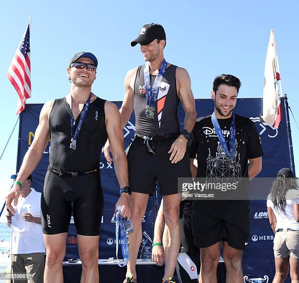 Actors Adan Canto Colin Egglesfield and Jack Falahee pose on the winners podium at the Nautica Malibu Triathlon at Zuma beach on September 20 2015 in...