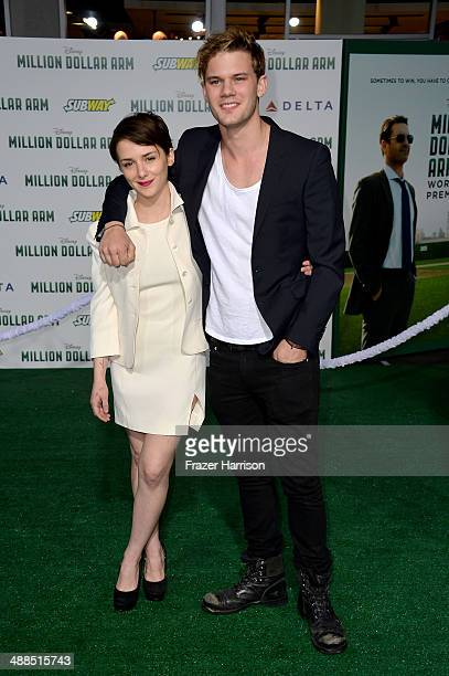 Actors Addison Timlin and Jeremy Irvine attend the premiere of Disney's Million Dollar Arm at the El Capitan Theatre on May 6 2014 in Hollywood...