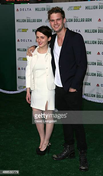 Actors Addison Timlin and Jeremy Irvine attend the premiere of Disney's 'Million Dollar Arm' at the El Capitan Theatre on May 6 2014 in Hollywood...