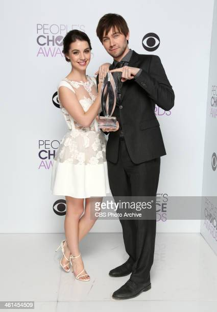 Actors Adelaide Kane and Torrance Coombs pose in the CBS/People's Choice Awards Photo Booth during The 40th Annual People's Choice Awards at Nokia...