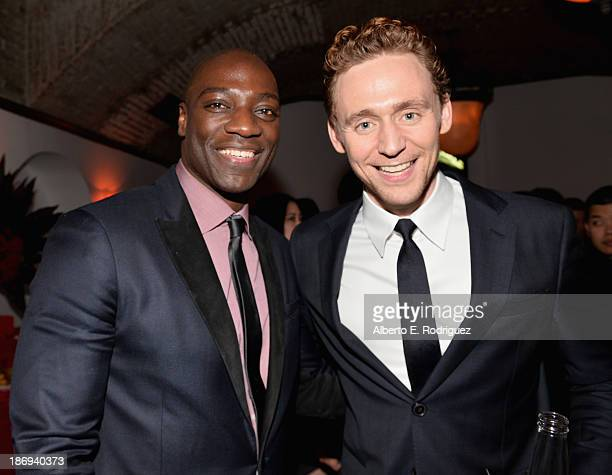 Actors Adewale AkinnuoyeAgbaje and Tom Hiddleston attend Marvel's Thor The Dark World Premiere after party at Cashmere Nightclub on November 4 2013...