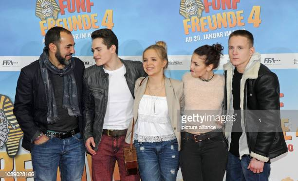 Actors Adnan Maral Justus Schlingensiepen Neele Marie Nickel Valerie Eisenbart and Querin Oettl pose in front of the movie poster at the premiere of...