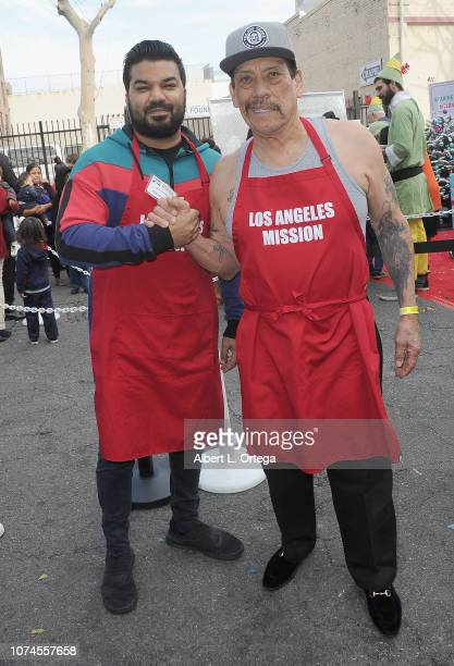 Actors Adrian Dev and Danny Trejo attend the Los Angeles Mission Christmas On Skid Row held at Los Angeles Mission on December 21 2018 in Los Angeles...