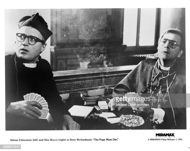 Actors Adrian Edmondson and Alex Rocco on the set of the movie 'The Pope Must Die' circa 1991