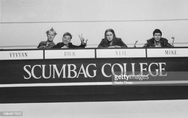 Actors Adrian Edmondson Rik Mayall Nigel Planner and Christopher Ryan in a 'University Challenge' scene from episode 'Bambi' of the television sitcom...