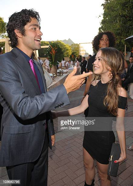 Actors Adrian Grenier and Alexis Dziena arrive on the red carpet of the Los Angeles premiere of the six season of Entourage at the Paramount Theater...