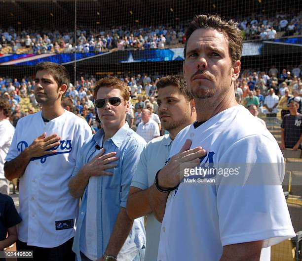 Actors Adrian Grenier, Kevin Connolly, Jerry Ferrara and Kevin Dillon during the national anthem at Dodger Stadium on June 26, 2010 in Los Angeles,...