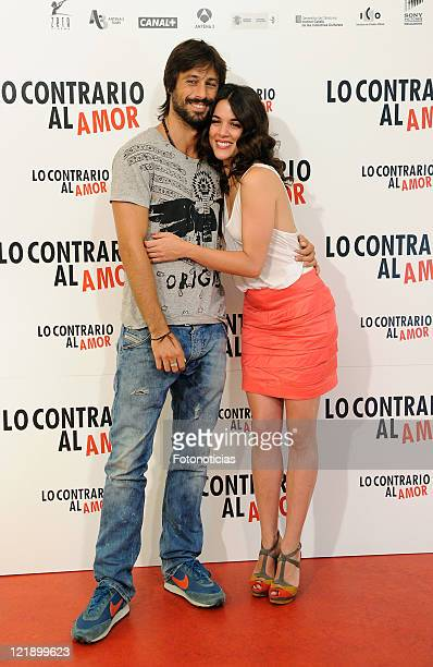 Actors Adriana Ugarte and Hugo SIlva attend a photocall for 'Lo Contrario al Amor' at Sony building on August 23 2011 in Madrid Spain