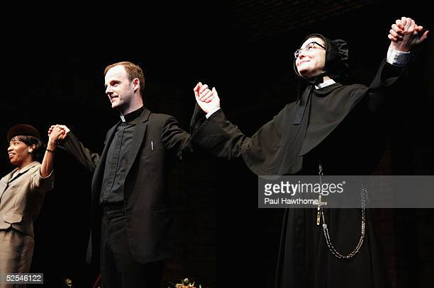 Actors Adriane Lenox Brian F O'Byrne and Cherry Jones perform during the curtain call of 'Doubt' at the Walter Kerr Theater on March 31 2005 in New...