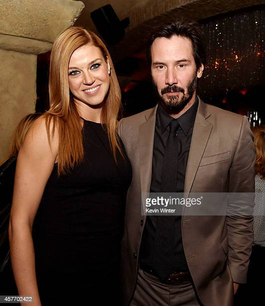 Actors Adrianne Palicki and Keanu Reeves pose at the after party for the screening of Lionsgate Films' John Wick at the Roosevelt Hotel on October 22...