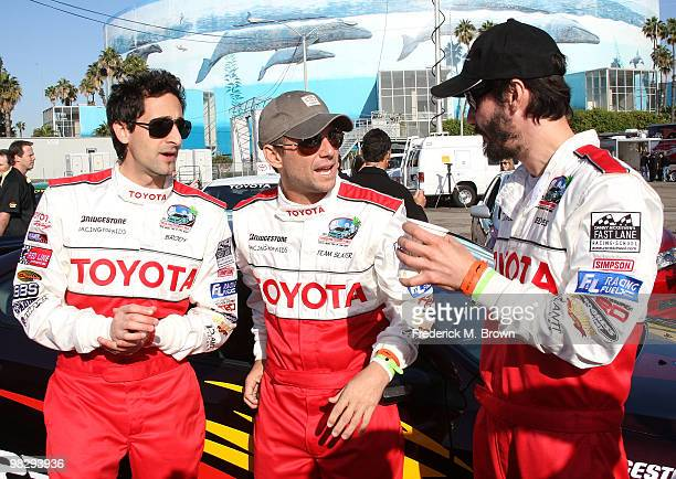 Actors Adrien Brody Christian Slater and Keanu Reeves pose for photographers during the press practice day for the Toyota Pro/ Celebrity Race on...