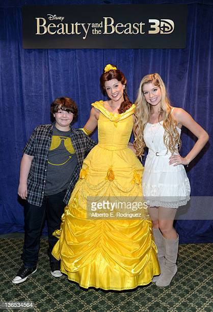 Actors Aedin Mincks and Allie Deberry pose with Belle at a Special Screening of Beauty and the Beast 3D at the El Capitan Beauty and the Beast 3D...