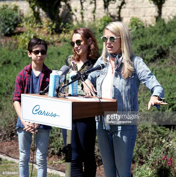 Actors Aidan Gallagher Anna Schafer and Sarah Wright Olsen attend Caruso hosts a community garden in honor of Earth Day in partnership with...